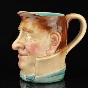 Antique Sarreguemines maiolica Jolly fellow face jug