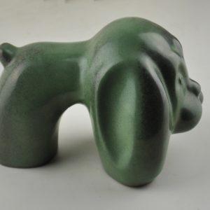 The ceramic green dog