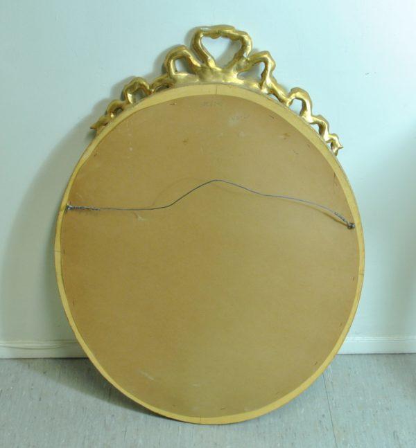 Kuldse raamiga seinapeegel