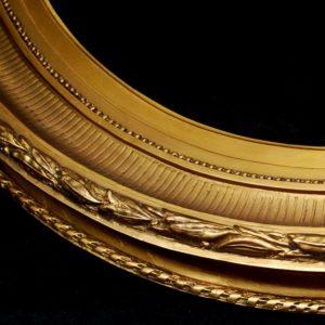 Oval shaped gilt wood frame