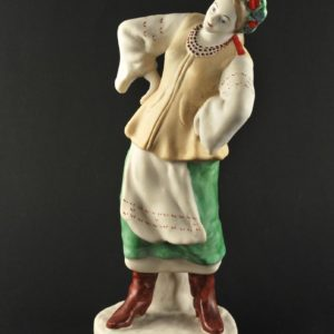 Porcelain figure - woman in folk clothing