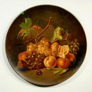 Large terracotta wall plate with fruits
