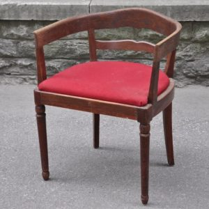 Old writing desk with red fabric
