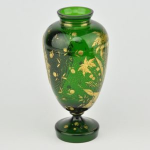 An old-fashioned glass vase with a porcelain plate, hand painting