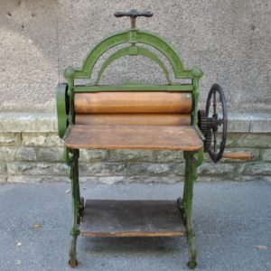 An antique cast-iron presser bar