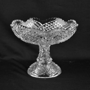 Antique press a glass bowl with a handle