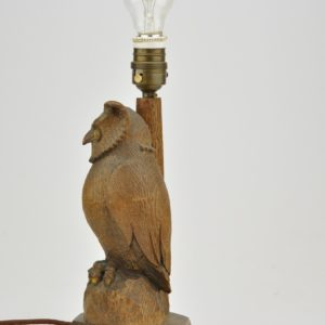 Old wooden desk lamp with owl