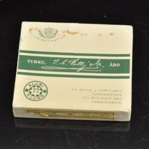 "An old cigar box ""Klubi77"" with paper lines in Finland"