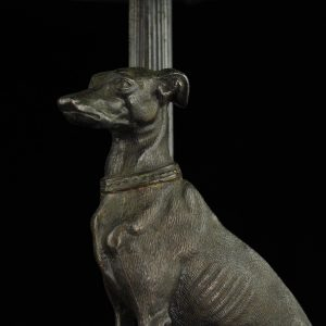 Art Nouveau table lamp with a bronze dog and green dome