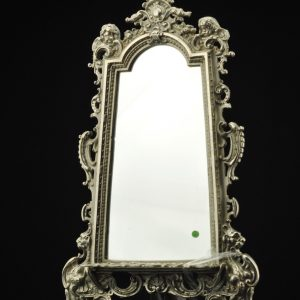 Antique wall mirror with a metal frame