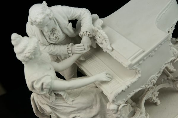 Antique biscuit porcelain figure , rococo style , man and woman with piano