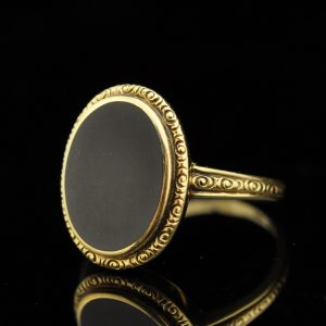 Antique gold ring with black onyx