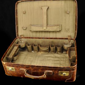 Antique crocodile leather travelling suitcase