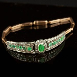 Antique gold bracelet with emeralds and diamonds