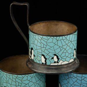 Vintage Russian teaglass holders with enamel design, penguins
