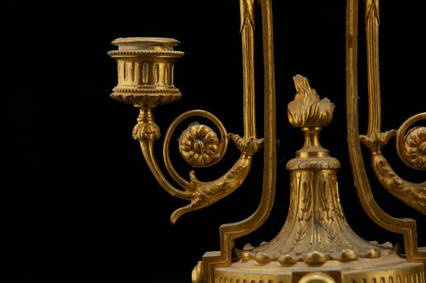Pair of antique bronze candle holders