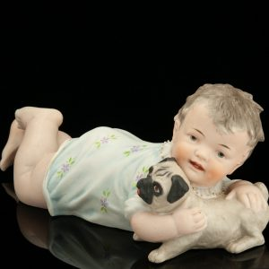 "Antique porcelain figure ""Piano Doll"""