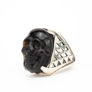 Antique silver ring with a skull