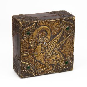 Antique wood box with bronze bird decorations