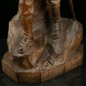 Antique wood sculpture of a hunter