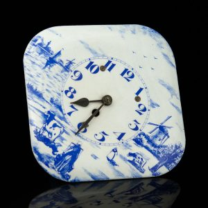 Antique enamel wall clock with windmills, blue and white