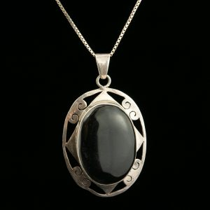 Silver pendant with black stone