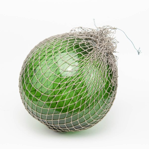 Antique green sea buoy with net