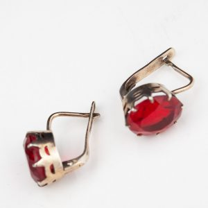 Silver earrings, red stones