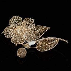Filigree silver flower brooch