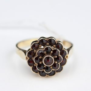 Silver gilt ring with garnets