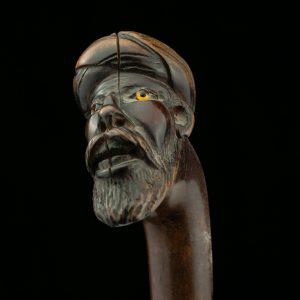 Antique wood walking stick , mans head